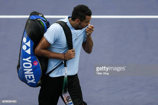 Nick Kyrgios of Australia reacts after retiring from the Men's singles mach against Steve Johnson of United States on day 3 of Shanghai Rolex Masters...