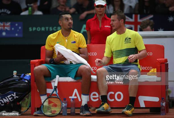 Nick Kyrgios of Australia receives advice from Captain Lleyton Hewitt in the match against David Goffin of Belgium during day three of the Davis Cup...