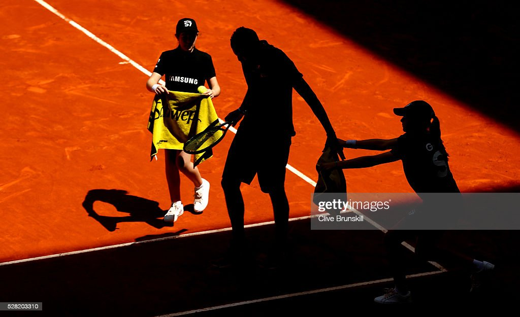 <a gi-track='captionPersonalityLinkClicked' href=/galleries/search?phrase=Nick+Kyrgios&family=editorial&specificpeople=6705178 ng-click='$event.stopPropagation()'>Nick Kyrgios</a> of Australia receives his towels from the ball kids during his straight sets victory against Stanislas Wawrinka of Switzerland in their second round match during day five of the Mutua Madrid Open tennis tournament at the Caja Magica on May 04, 2016 in Madrid.