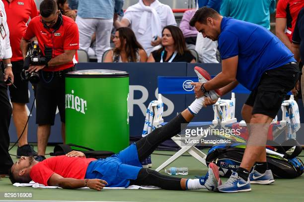 Nick Kyrgios of Australia receives medical attention against Alexander Zverev of Germany during day seven of the Rogers Cup presented by National...