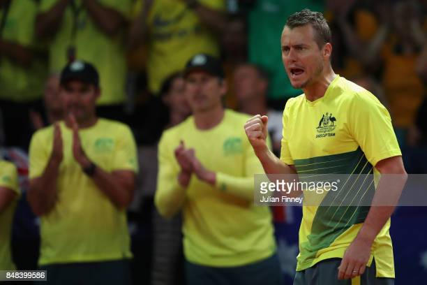 Nick Kyrgios of Australia receives support from Captain Lleyton Hewitt in the match against David Goffin of Belgium during day three of the Davis Cup...