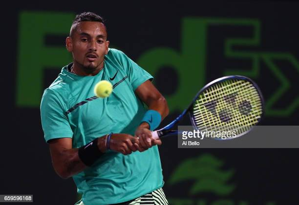 Nick Kyrgios of Australia returns a shot against David Goffin of Belguim during Day 9 of the Miami Open at Crandon Park Tennis Center on March 28...