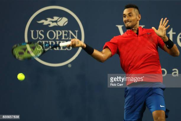 Nick Kyrgios of Australia returns a shot to David Ferrer of Spain during Day 8 of the Western and Southern Open at the Linder Family Tennis Center on...
