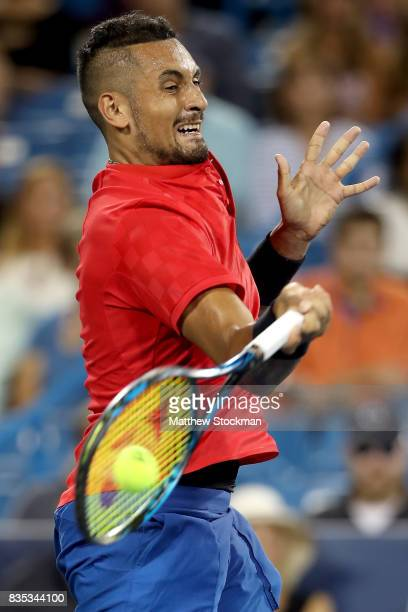 Nick Kyrgios of Australia returns a shot to Rafael Nadal of Spain during day 7 of the Western Southern Open at the Lindner Family Tennis Center on...