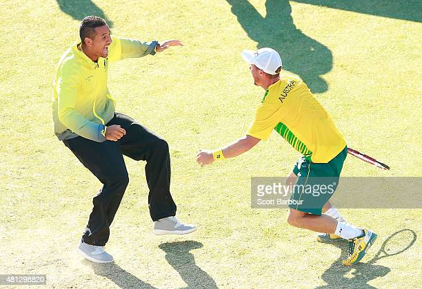 Nick Kyrgios of Australia runs on court to congratulate Lleyton Hewitt of Australia as he celebrates winning the reverse singles match between...