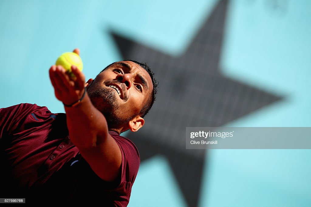 <a gi-track='captionPersonalityLinkClicked' href=/galleries/search?phrase=Nick+Kyrgios&family=editorial&specificpeople=6705178 ng-click='$event.stopPropagation()'>Nick Kyrgios</a> of Australia serves against Guido Pella of Argentina in their first round match during day four of the Mutua Madrid Open tennis tournament at the Caja Magica on May 03, 2016 in Madrid,Spain.