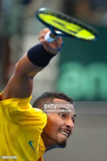 Nick Kyrgios of Australia serves against Sam Querrey of the US during their tennis match in the world group quarterfinal Davis Cup clash between...