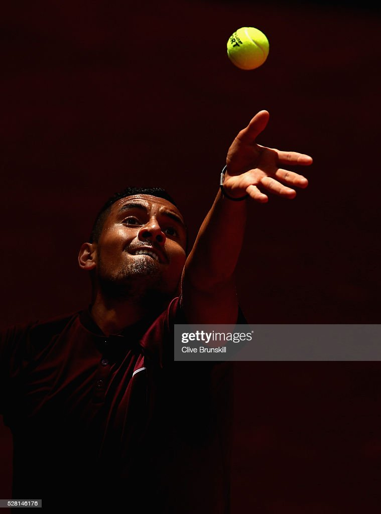 <a gi-track='captionPersonalityLinkClicked' href=/galleries/search?phrase=Nick+Kyrgios&family=editorial&specificpeople=6705178 ng-click='$event.stopPropagation()'>Nick Kyrgios</a> of Australia serves during his straight sets victory against Stanislas Wawrinka of Switzerland in their second round match during day five of the Mutua Madrid Open tennis tournament at the Caja Magica on May 04, 2016 in Madrid.