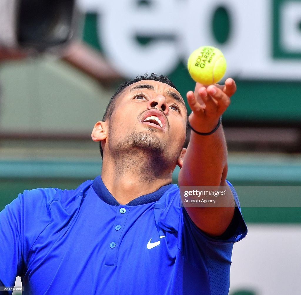 Nick Kyrgios of Australia serves to Richard Gasquet of France (not seen) during the men's single third round match at the French Open tennis tournament at Roland Garros Stadium in Paris, France on May 27, 2016.