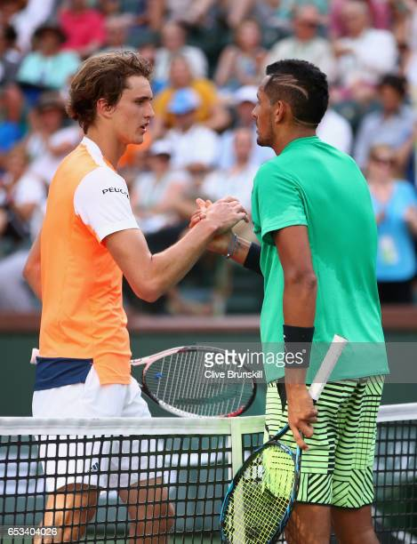 Nick Kyrgios of Australia shakes hands at the net after his straight sets victory against Alexander Zverev of Germany in their third round match...