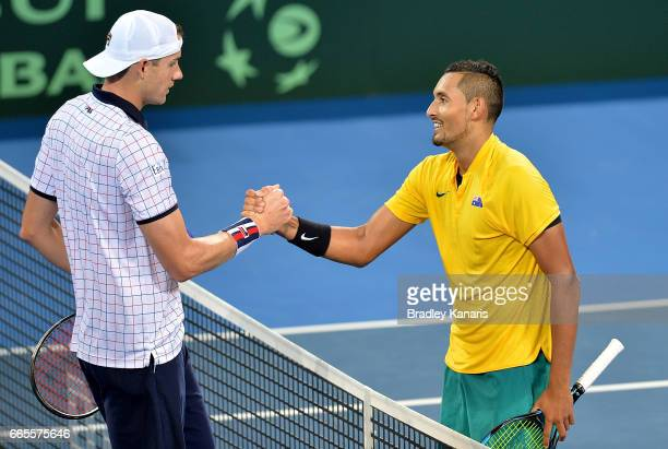 Nick Kyrgios of Australia shakes hands with John Isner after their match during the Davis Cup World Group Quarterfinals between Australia and the USA...