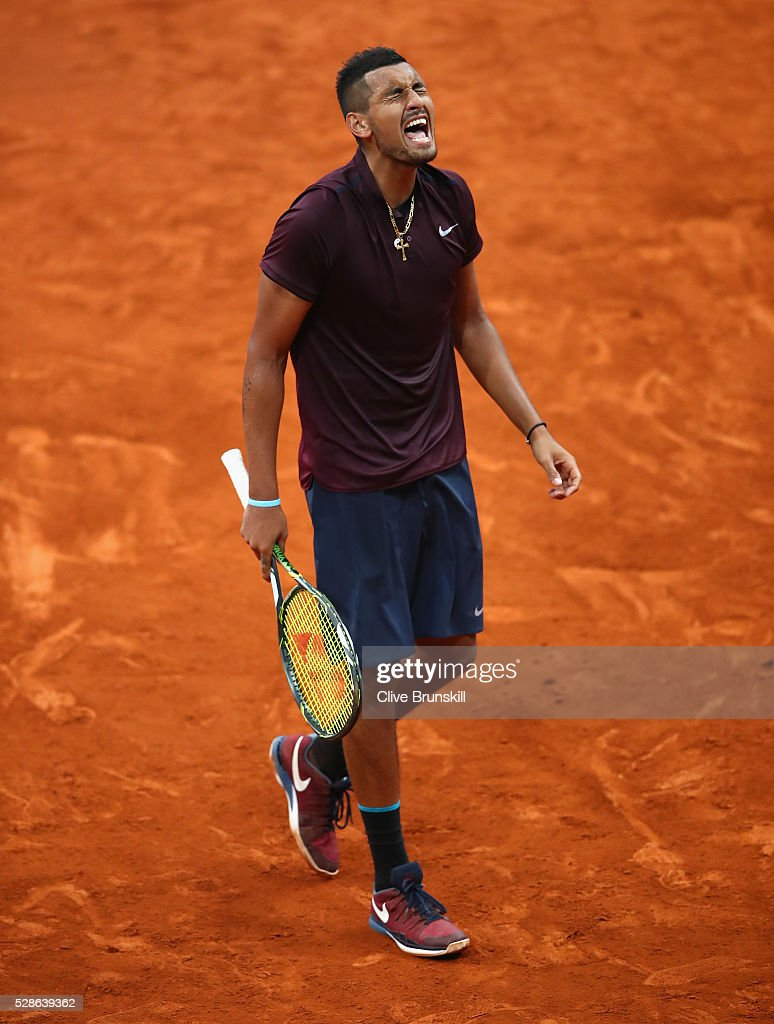 <a gi-track='captionPersonalityLinkClicked' href=/galleries/search?phrase=Nick+Kyrgios&family=editorial&specificpeople=6705178 ng-click='$event.stopPropagation()'>Nick Kyrgios</a> of Australia shows his emotions during his three set defeat against Kei Nishikori of Japan in their quarter final round match during day seven of the Mutua Madrid Open tennis tournament at the Caja Magica on May 06, 2016 in Madrid,Spain.