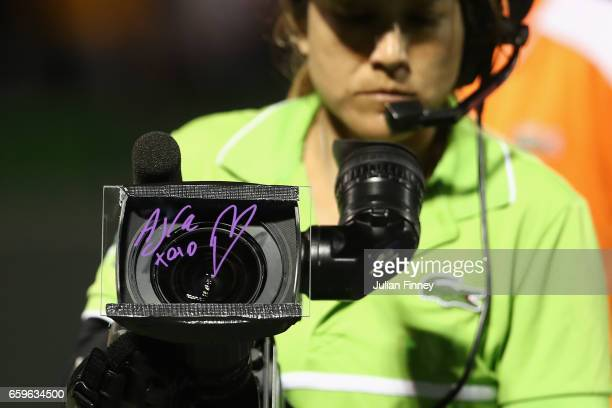 Nick Kyrgios of Australia signs a message on the TV camera after his match against David Goffin of Belgium at Crandon Park Tennis Center on March 28...
