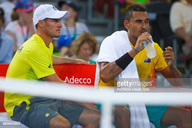 Nick Kyrgios of Australia sits with team captain Lleyton Hewitt during his tennis match against John Isner of the US in the world group quarterfinal...