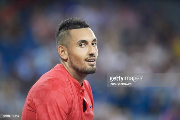 Nick Kyrgios of Australia smiles at his team box after winning the semifinal match against David Ferrer of Spain in the Western Southern Open at the...