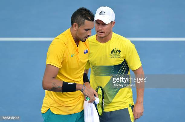 Nick Kyrgios of Australia talks tactics with Team Captain Lleyton Hewitt after his match against Sam Querrey of the USA during the Davis Cup World...