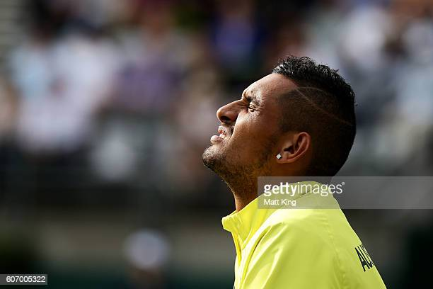 Nick Kyrgios of Australia watches the doubles match between Sam Groth and John Peers of Australia and Andrej Martin and Igor Zelenay of Slovakia...
