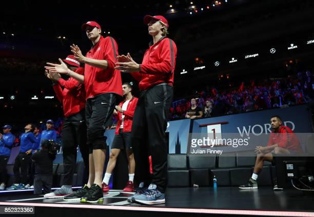 Nick Kyrgios of Team World watches as Denis Shapovalov John Isner and Frances Tiafoe of Team World clap as Rafael Nadal of Team Europe plays his...