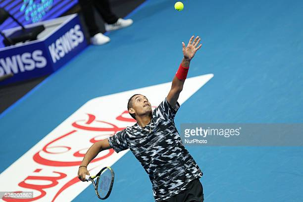Nick Kyrgios of the Singapore Slammers serves to Gael Monfils and Rohan Bopanna of the Indian Aces during their doubles match at the International...
