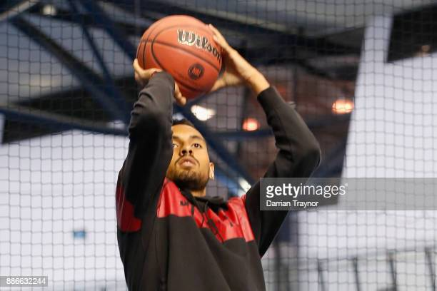 Nick Kyrgios plays basketball during an Australian Open announcement at Melbourne Park on December 6 2017 in Melbourne Australia