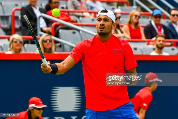 Nick Kyrgios plays with a ball at warmup before his first round match at ATP Coupe Rogers on August 7 at Uniprix Stadium in Montreal QC