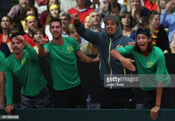 Nick Kyrgios Thanasi Kokkinakis and Alexei Popyrin of Australia celebrate a point as John Peers and Jordan Thompson of Australia play in the doubles...