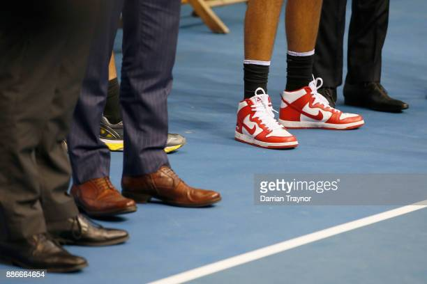 Nick Kyrgios wears his basketball shoes during an Australian Open announcement at Melbourne Park on December 6 2017 in Melbourne Australia