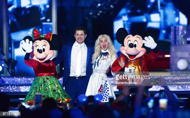 Nick Lachey and Julianne Hough perform during the taping of 'The Wonderful World Of Disney Magical Holiday Celebration' at Walt Disney World on...