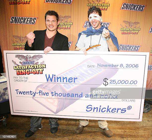 Nick Lachey and Michael Beaudoin winner of Snickers 'Satisfaction Singoff' for his song 'Super Snickers Bar'