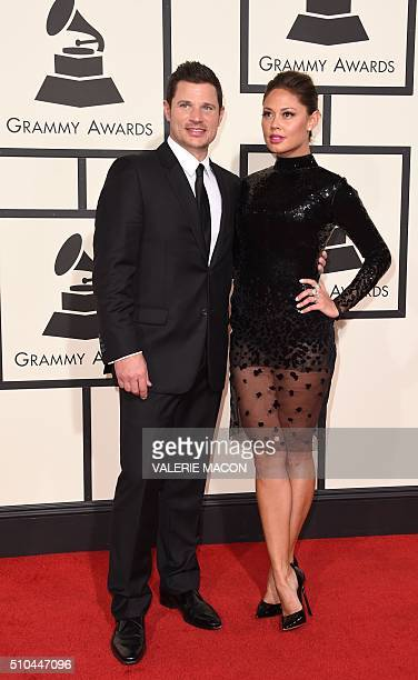Nick Lachey and Vanessa Lachey arrive on the red carpet for the 58th Annual Grammy music Awards in Los Angeles February 15 2016 AFP PHOTO/ VALERIE...