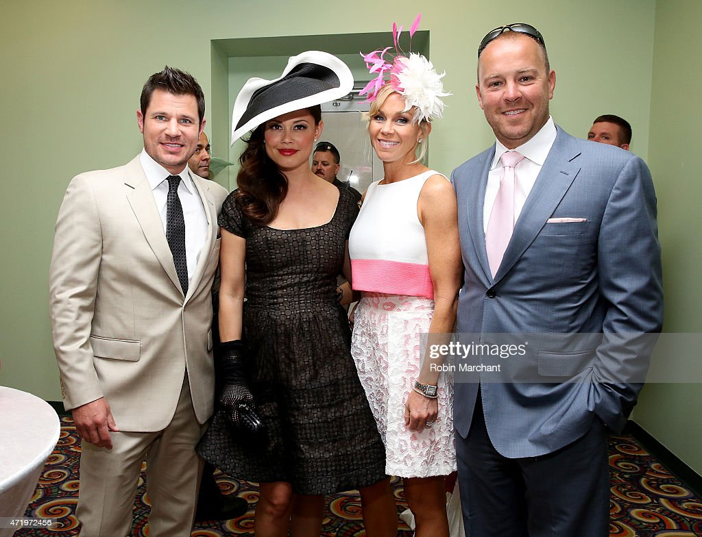Nick Lachey and Vanessa Lachey pose with guests at the 141st Kentucky Derby at Churchill Downs on May 2, 2015 in Louisville, Kentucky.