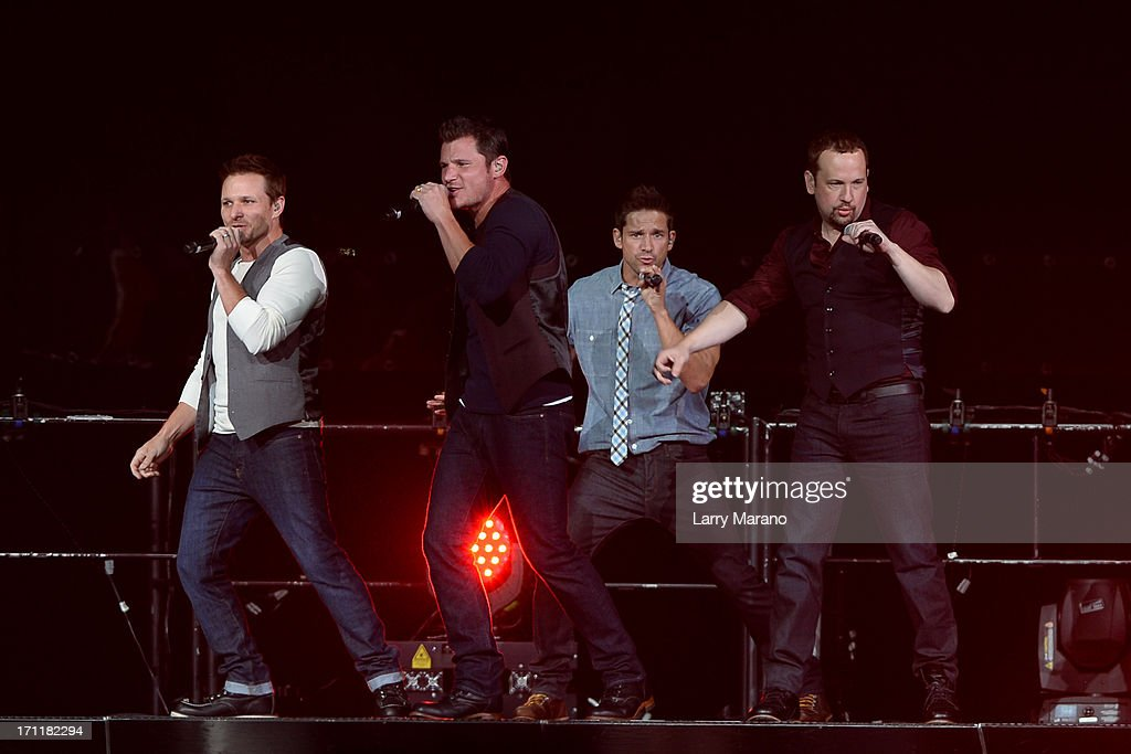 Nick Lachey, Drew Lachey, Justin Jeffre and Jeff Timmons of 98 Degrees perform during The Package Tour at BB&T Center on June 22, 2013 in Sunrise, Florida.