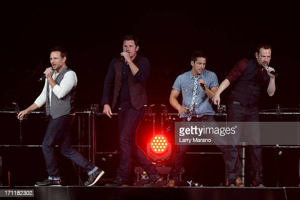 Nick Lachey Drew Lachey Justin Jeffre and Jeff Timmons of 98 Degrees perform during The Package Tour at BBT Center on June 22 2013 in Sunrise Florida