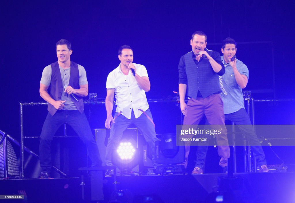 Nick Lachey Drew Lachey Justin Jeffre and Jeff Timmons of the band 98 Degrees perform at Staples Center on July 5 2013 in Los Angeles California