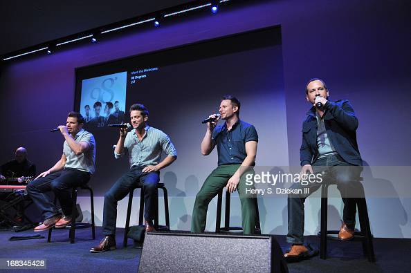 Nick Lachey Jeff Timmons Drew Lachey and Justin Jeffre of 98 Degrees perform at Meet the Musicians at the Apple Store Soho on May 8 2013 in New York...