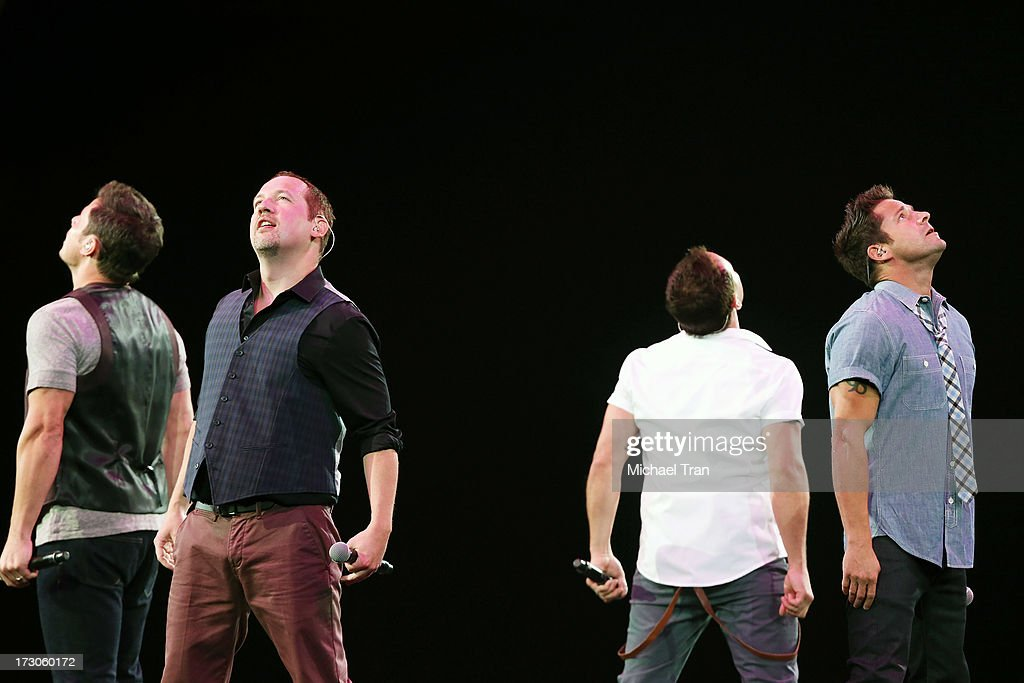 Nick Lachey Justin Jeffre Drew Lachey and Jeff Timmons of 98 Degrees perform onstage during 'The Package Tour' held at Staples Center on July 5 2013...