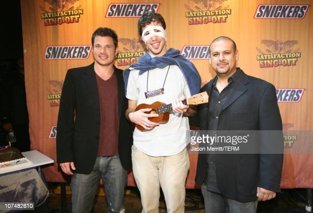 Nick Lachey Michael Beaudoin winner of Snickers 'Satisfaction Singoff' for his song 'Super Snickers Bar' and Vic Walia senior marketing manager...