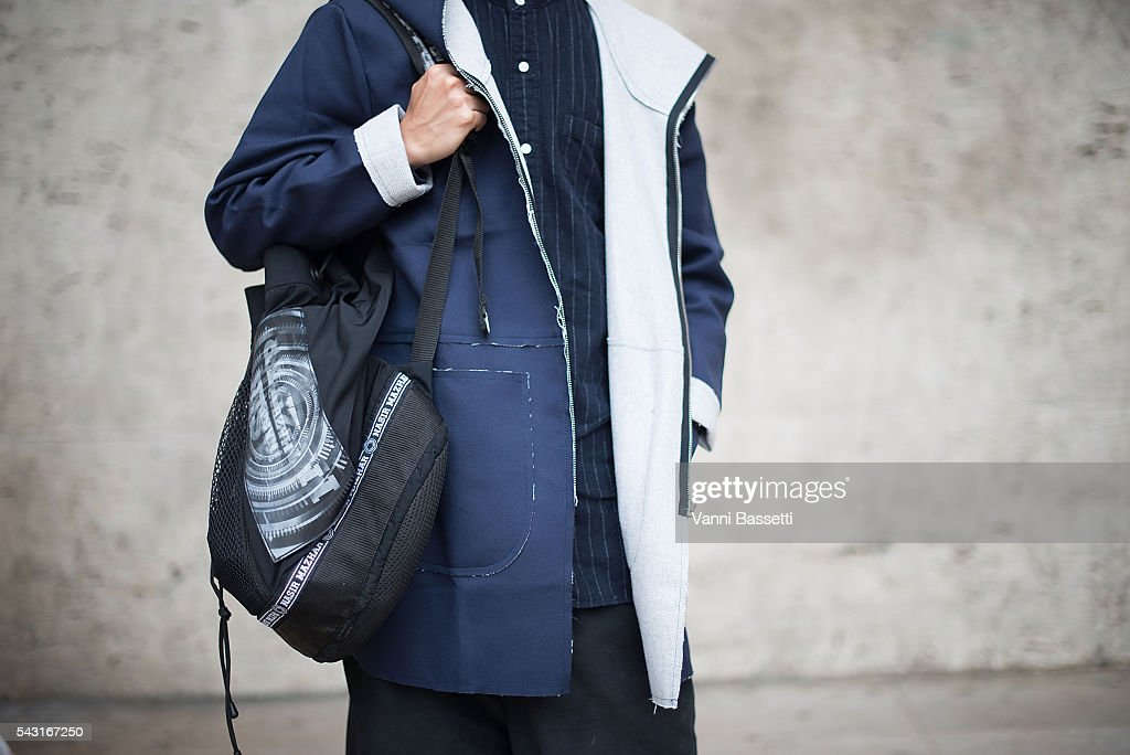 Nick Lam poses wearing a Soot and Ty coat and Nasir Mazhar backpack after the Lanvin show at the Palais de Tokyo during Paris Fashion Week Menswear SS17 on June 26, 2016 in Paris, France.