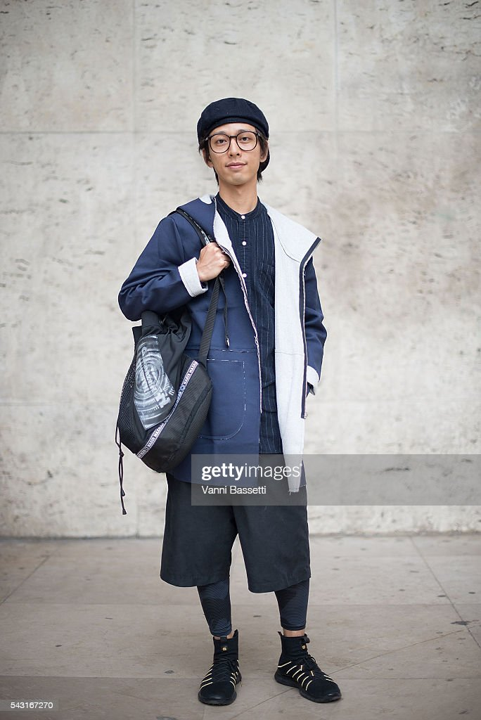 Nick Lam poses wearing a Soot and Ty coat, Nike shoes and Nasir Mazhar backpack after the Lanvin show at the Palais de Tokyo during Paris Fashion Week Menswear SS17 on June 26, 2016 in Paris, France.