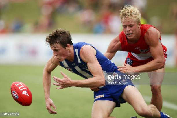 Nick Larkey of the Kangaroos is challenged by Isaac Heeney of the Swans during the 2017 JLT Community Series match between the Sydney Swans and North...