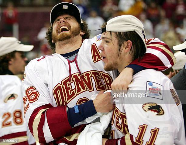 Nick Larson and Paul Stastny of the Denver Pioneers celebrate their victory over the North Dakota Fighting Sioux after the NCAA Frozen Four...