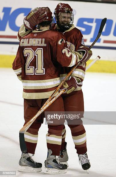 Nick Larson and Ryan Caldwell of the Denver Pioneers celebrate their win over the MinnesotaDuluth Bulldogs during the NCAA Frozen Four on April 8...