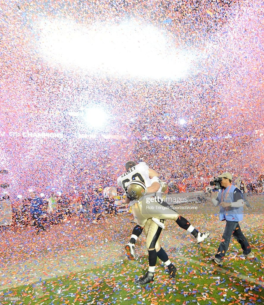 Nick Leckey #60 of the New Orleans Saints celebrates on the field with a teammate after defeating the Indianapolis Colts in Super Bowl XLIV on February 7, 2010 at Sun Life Stadium in Miami Gardens, Florida.
