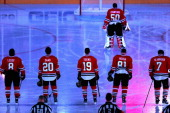 Nick Leddy Brandon Saad Jonathan Toews Corey Crawford Marian Hossa and Brent Seabrook of the Chicago Blackhawks stand during the National Anthem...