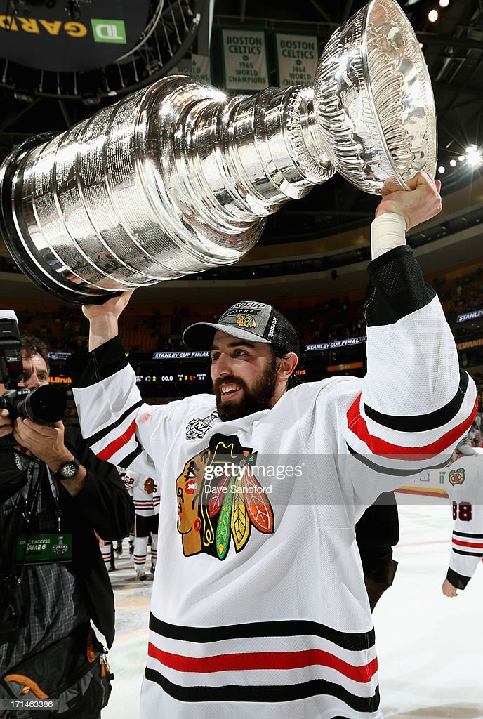 Nick Leddy #8 hoists the Stanley Cup after his team defeated the Boston Bruins 3-2 in Game Six of the 2013 Stanley Cup Final at TD Garden on June 24, 2013 in Boston, Massachusetts. The Chicago Blackhawks won the series 4-2 to win the Stanley Cup.
