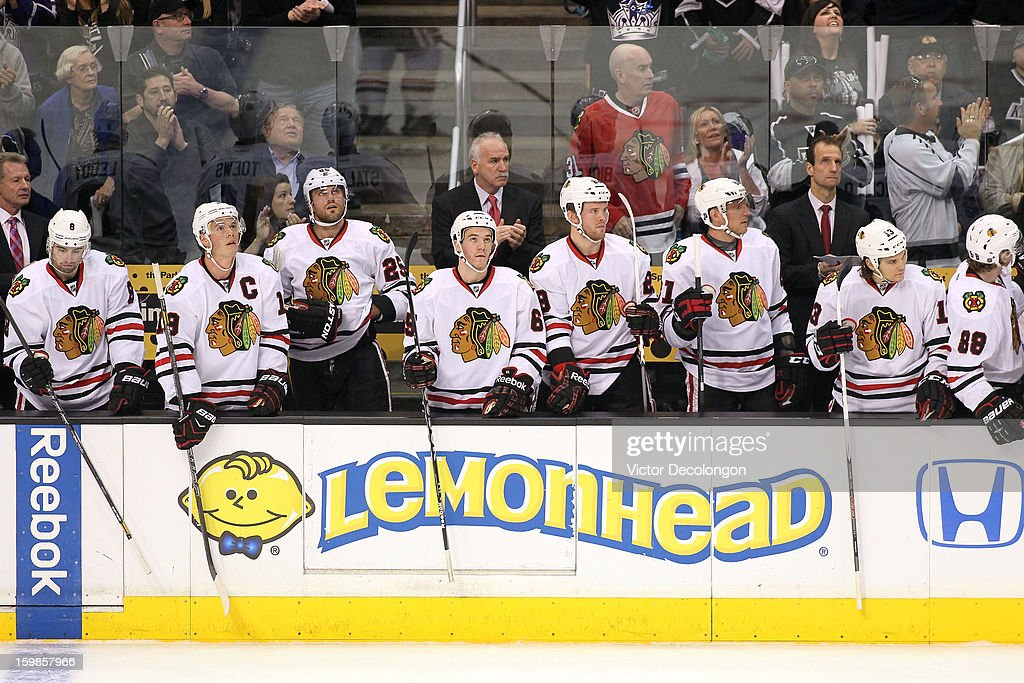 Nick Leddy #8, Jonathan Toews #19, Viktor Stalberg #25, Andrew Shaw #65, Head Coach Joel Quenneville, Bryan Bickell #29, Marian Hossa #81, Assistant Coach Jamie Kompon, and Daniel Carcillo #13 of the Chicago Blackhawks look on from the bench area during the NHL game the Los Angeles Kings at Staples Center on January 19, 2013 in Los Angeles, California. The Blackhawks defeated the Kings 5-2.