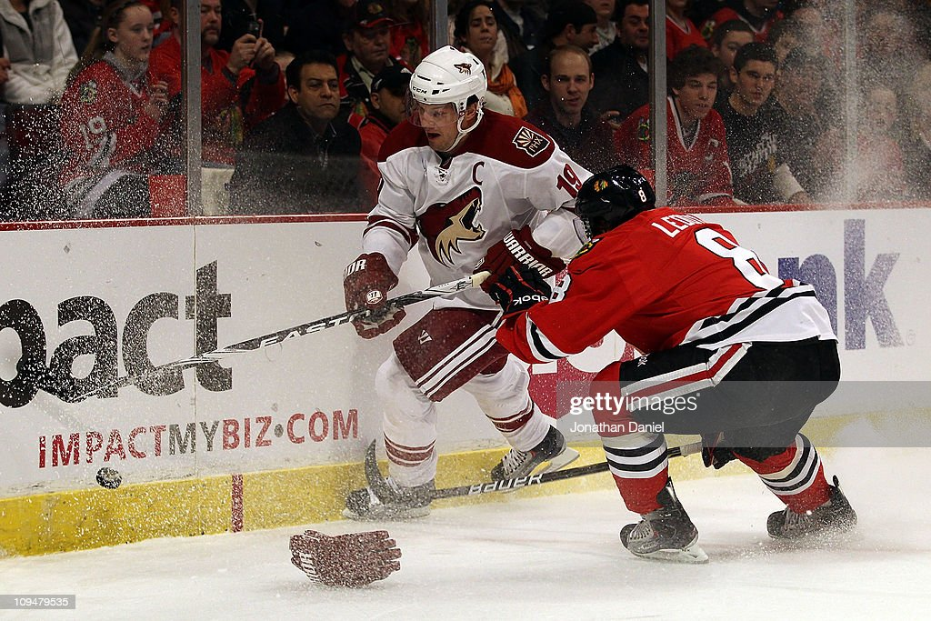 Nick Leddy of the Chicago Blackhawks battles for the puck with Shane Doan of the Phoenix Coyotes at the United Center on February 27 2011 in Chicago...