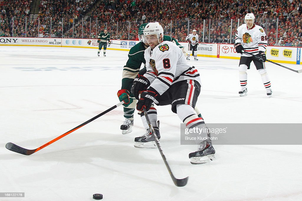 <a gi-track='captionPersonalityLinkClicked' href=/galleries/search?phrase=Nick+Leddy&family=editorial&specificpeople=5894600 ng-click='$event.stopPropagation()'>Nick Leddy</a> #8 of the Chicago Blackhawks battles with <a gi-track='captionPersonalityLinkClicked' href=/galleries/search?phrase=Matt+Cullen&family=editorial&specificpeople=536122 ng-click='$event.stopPropagation()'>Matt Cullen</a> #7 of the Minnesota Wild for the puck in Game Three of the Western Conference Quarterfinals during the 2013 NHL Stanley Cup Playoffs on May 5, 2013 at the Xcel Energy Center in St. Paul, Minnesota.