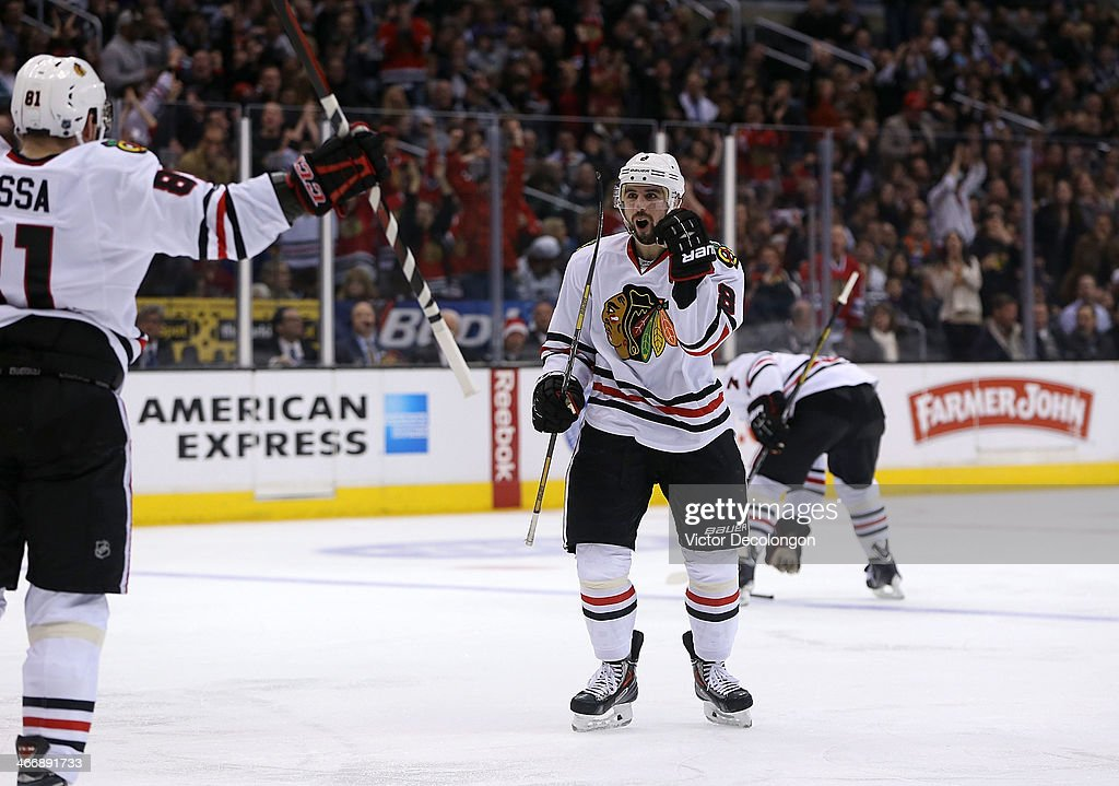 <a gi-track='captionPersonalityLinkClicked' href=/galleries/search?phrase=Nick+Leddy&family=editorial&specificpeople=5894600 ng-click='$event.stopPropagation()'>Nick Leddy</a> #8 of the Chicago Blackhawks celebrates his third period goal against the Los Angeles Kings during the NHL game at Staples Center on February 3, 2014 in Los Angeles, California. The Blackhawks defeated the Kings 5-3.