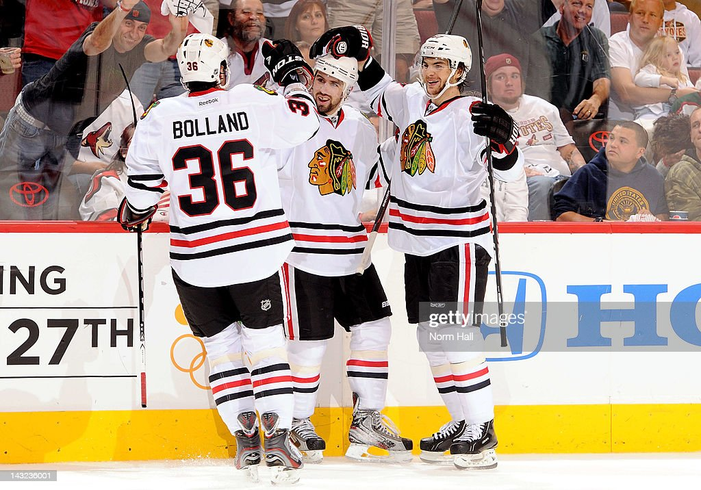 Nick Leddy of the Chicago Blackhawks celebrates with teammates Dave Bolland and Michael Frolik after scoring against the Phoenix Coyotes in Game Five...